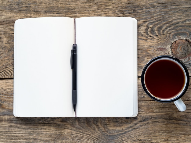 Open notebook on a spring with a white paper for notes and drawing Premium Photo