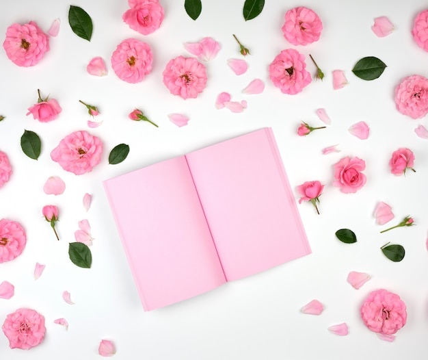 Open notebook with pink blank pages Premium Photo
