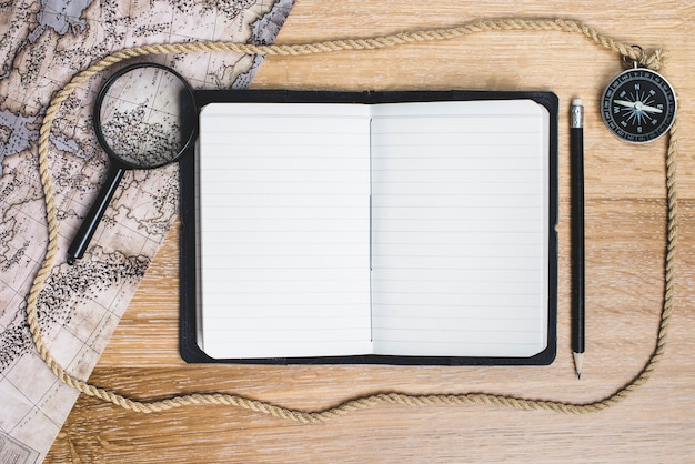Open notebook to write the adventure Free Photo