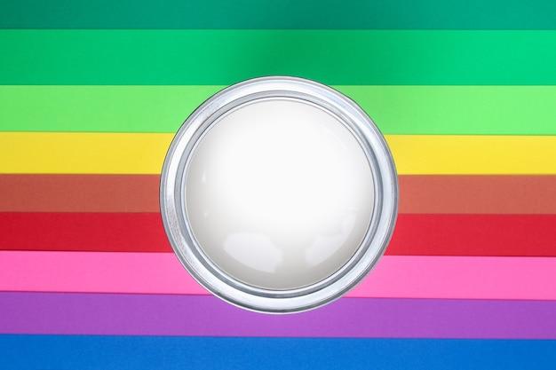 Open paint enamel cans on color palette samples Premium Photo