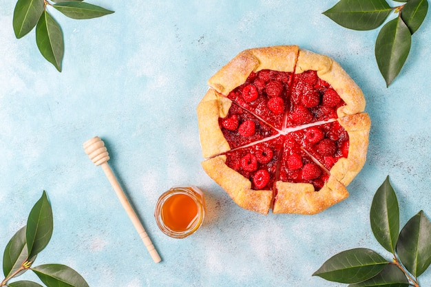 Open pie, raspberry galette. summer berry dessert. Free Photo