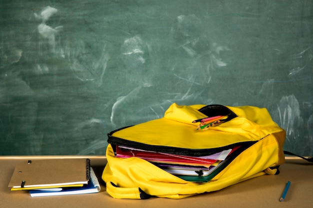 Open yellow rucksack with copybooks Free Photo