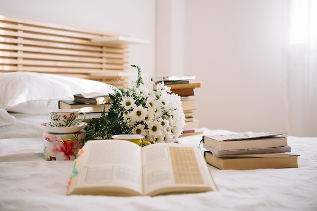 Opened book on bed Free Photo