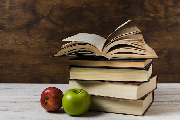 Opened book on a pile front view Free Photo