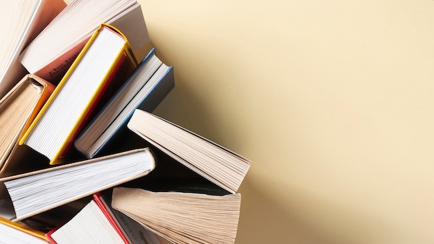 Opened books on table with copy space Free Photo