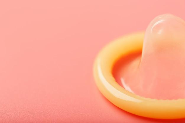 Opened condom, close-up, top view. Premium Photo