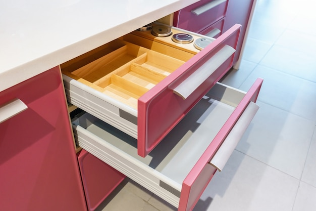Opened kitchen drawer with plates inside, a smart solution for kitchen storage and organizing Premium Photo