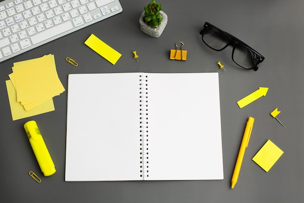 Opened notebook and other office equipment such as computer keyboard, Premium Photo