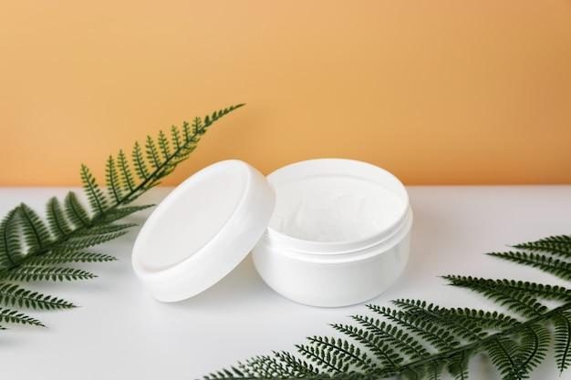 Opened plastic container jar with cream Premium Photo