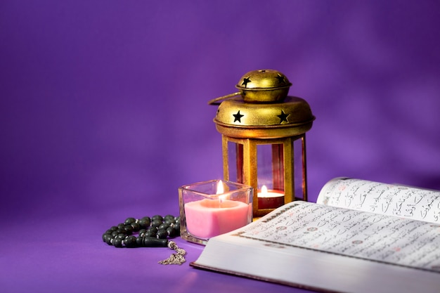 Opened quran with spiritual elements Free Photo