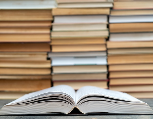 Opened thick book. symbol of wisdom, knowledge and learning. Premium Photo