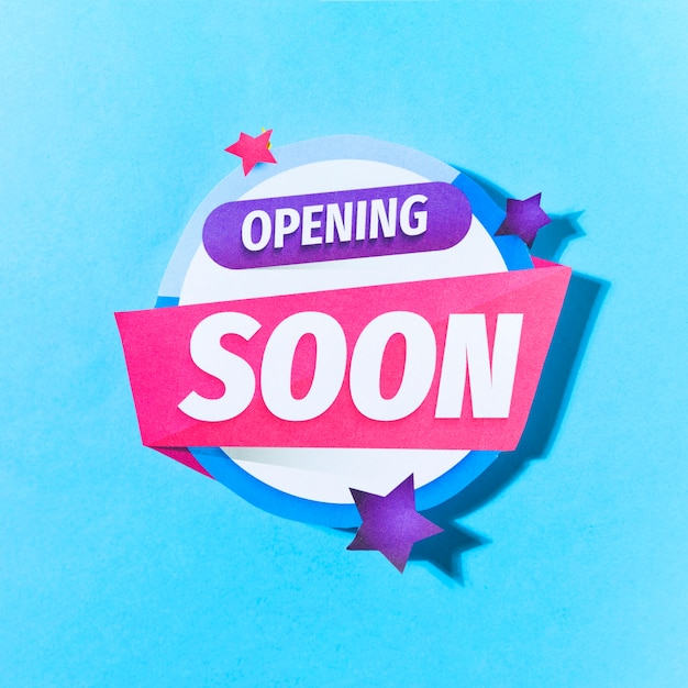 Opening soon text with stars on blue background Free Photo