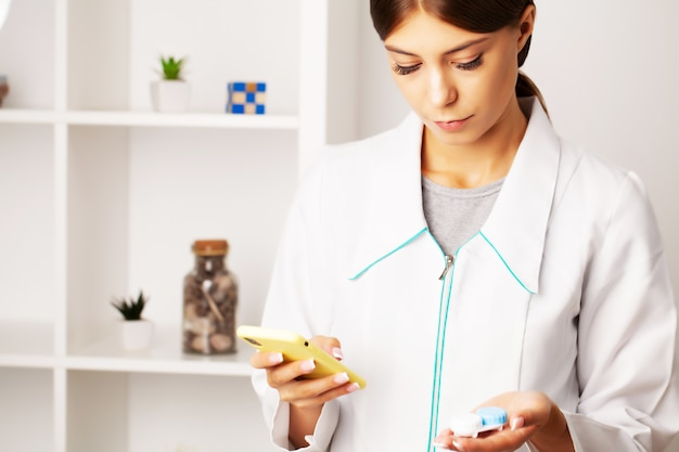 The ophthalmologist advises the patient by phone, helping with the choice of contact lenses for vision Premium Photo