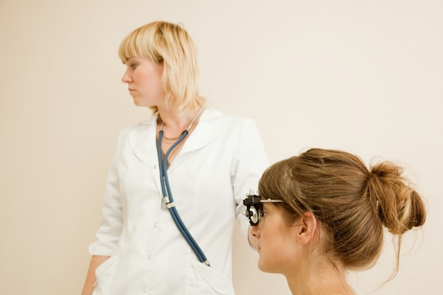 Ophthalmologist  and patient Free Photo