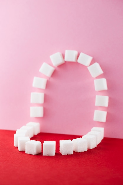 Oral cavity made with sweet sugar cubes Free Photo