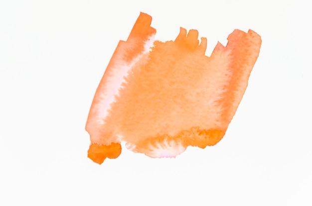 An orange abstract orange watercolor splash isolated on white backdrop Free Photo