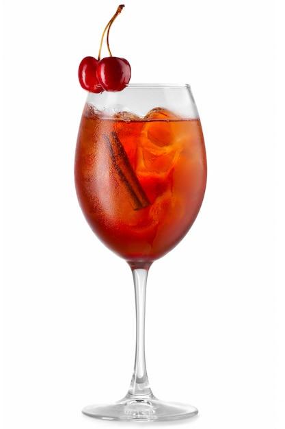 Orange alcohol cocktail with cherry berries isolated Premium Photo
