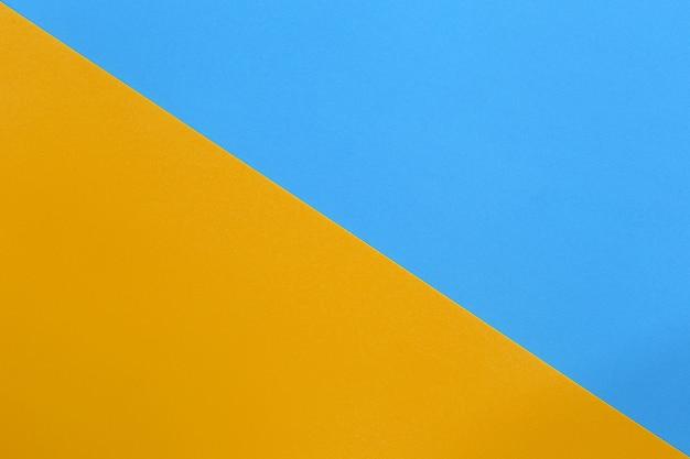 オレンジと青の段ボールアートペーパー。 Premium写真