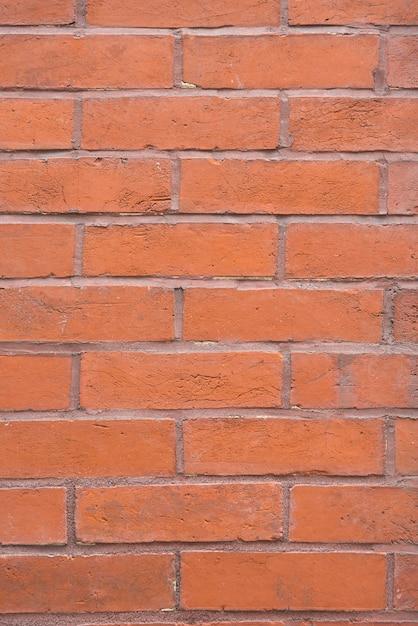 Orange brick wall background Free Photo