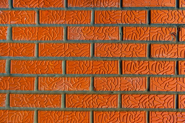 Оранжевая кирпичная кладка крупным планом нового здания Premium Фотографии