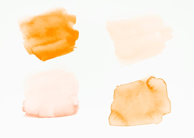 An orange brush strokes isolated on white backdrop Free Photo