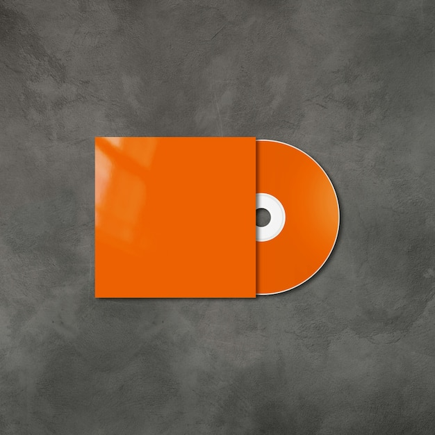Orange cd - dvd label and cover mockup template isolated on concrete background Premium Photo