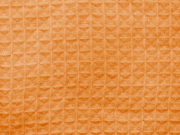Orange cloth with seamless crocheted pattern Free Photo