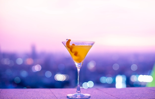 Orange cocktail at a rooftop Free Photo