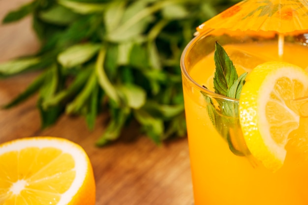 Orange drink with lemon slice Free Photo