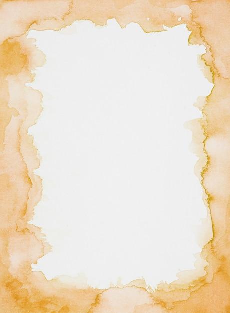 Orange frame of paints on white sheet Free Photo
