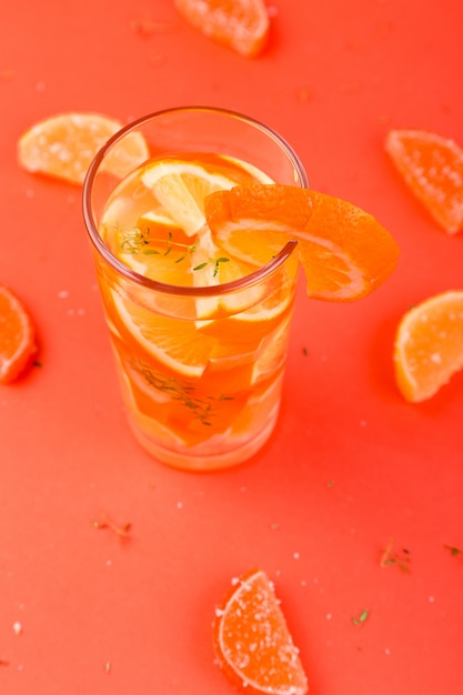 Orange fruit cocktail, detox water on orange surface Premium Photo