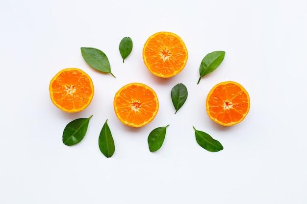 Orange fruits with  leaves on white background. Premium Photo