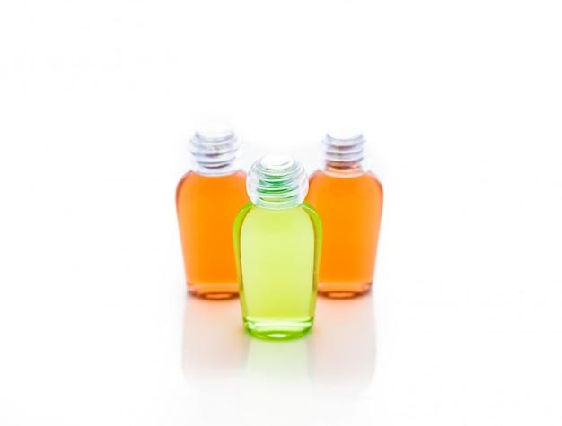 Orange and green bottle of shampoo Premium Photo