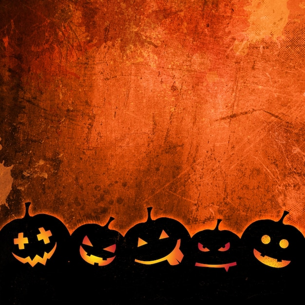 orange grunge background for halloween with pumpkins photo