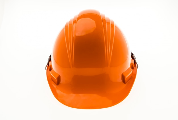 Orange hard plastic construction helmet on white background . Free Photo
