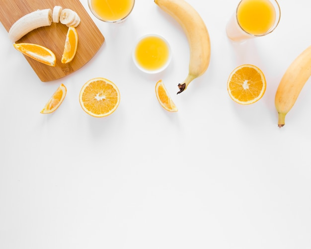 Orange juice and bananas with copy space Free Photo