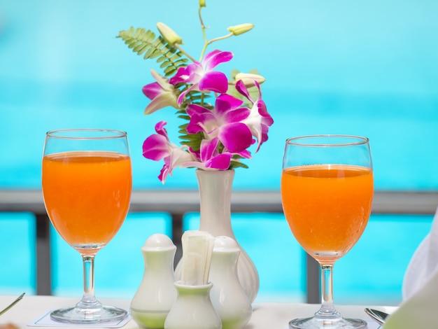 Orange juice fresh for drink at swiming pool Premium Photo
