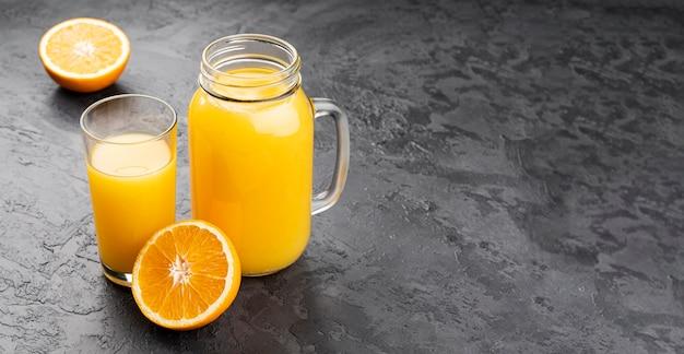 Orange juice in jar with copy space Free Photo