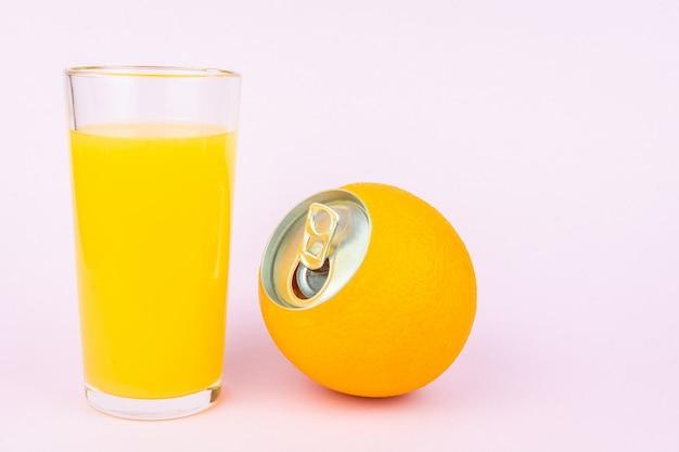Orange juice on pink background Premium Photo