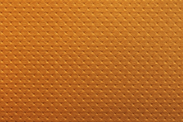 Orange leather texture background with tile pattern. Premium Photo