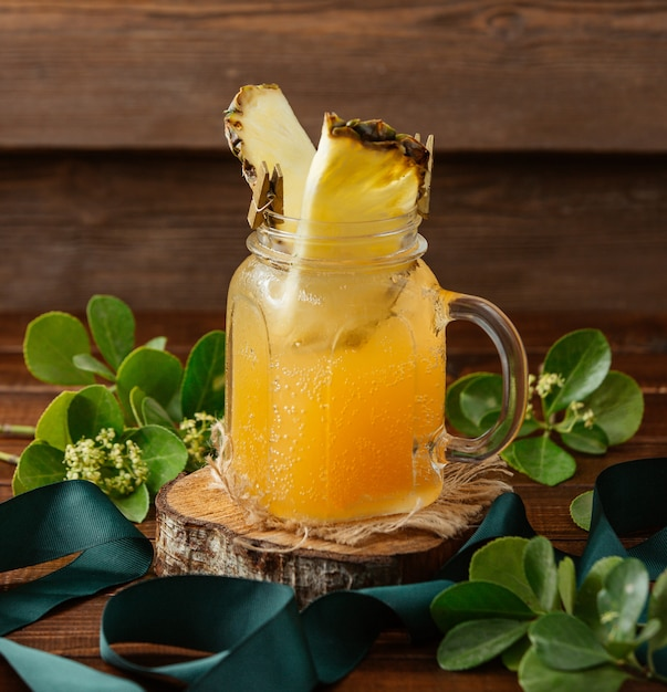 Orange lemonade with pineapple slice Free Photo