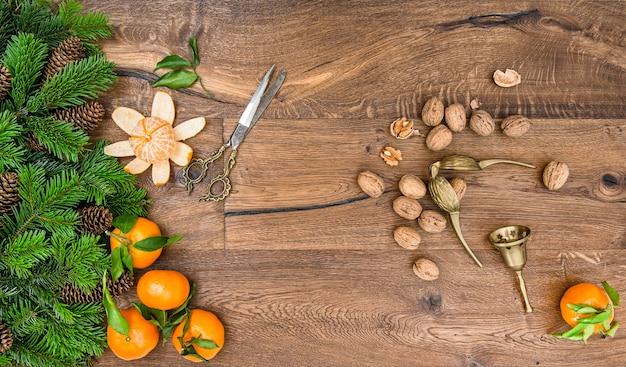 Orange mandarin fruits, walnuts and vintage accessories Premium Photo