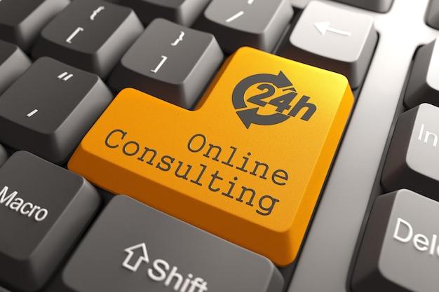 Оранжевая кнопка онлайн-консультации на клавиатуре компьютера Premium Фотографии