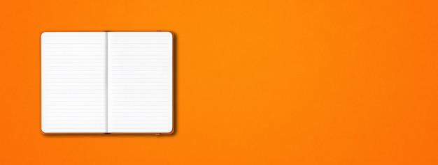 Оранжевый макет ноутбука с открытой подкладкой, изолированный на оранжевом Premium Фотографии