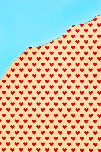 Оранжевая бумага с фоном красных сердечек Бесплатные Фотографии