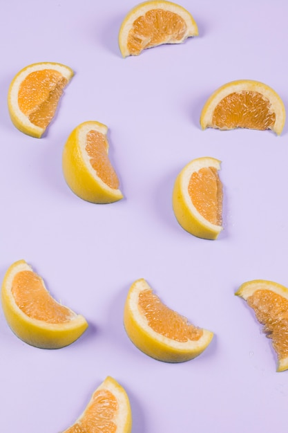 An orange slices on purple background Free Photo