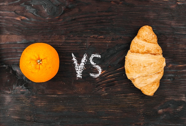 Orange vs crossiant Free Photo