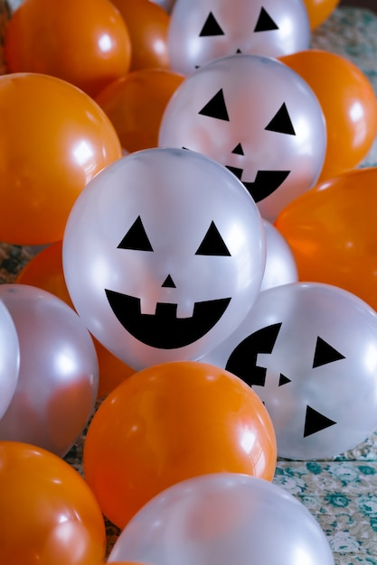 Orange and white halloween balloons Premium Photo
