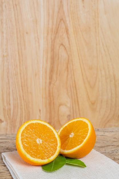 Orange on the wooden floor. Free Photo