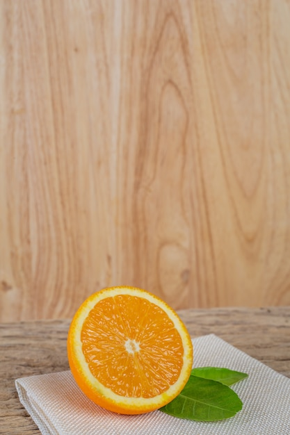 Orange on the wooden floor. Free Photo
